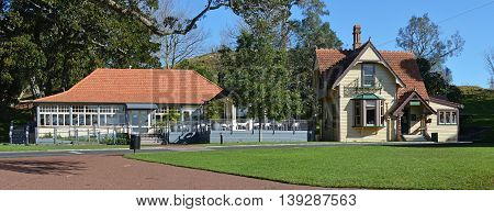 Panoramic View of the Historic Visitors' centre and restaurant buildings on Auckland's most popular tourist attraction - One Tree Hill in cornwall park New Zealand.