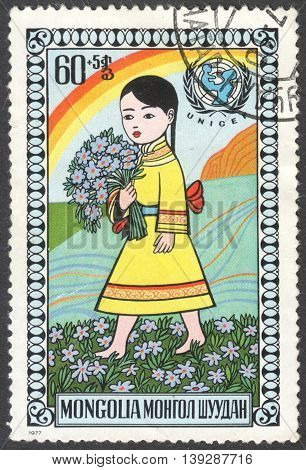 MOSCOW RUSSIA - CIRCA FEBRUARY 2016: a post stamp printed in MONGOLIA shows a happy child the series