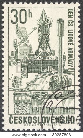 MOSCOW RUSSIA - JANUARY 2016: a post stamp printed in CZECHOSLOVAKIA shows military vehicles the series