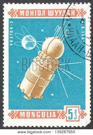 MOSCOW RUSSIA - CIRCA JANUARY 2016: a post stamp printed in MONGOLIA shows space satellite