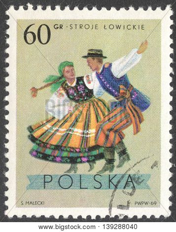 MOSCOW RUSSIA - CIRCA JANUARY 2016: a post stamp printed in POLAND shows traditional Polish dancing the series