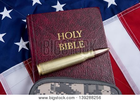Religion and peace with fifty caliber bullet bible and American flag .
