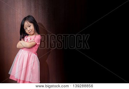 Portrait Of A Little Asian Kid Girl With Arms Crossed Acting