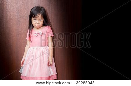 Portrait Of A Little Asian Kid Girl , Made To Shorten Mouth
