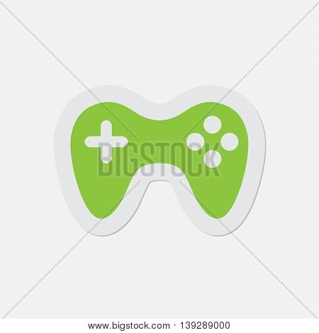 simple green icon with contour and shadow - gamepad on a white background