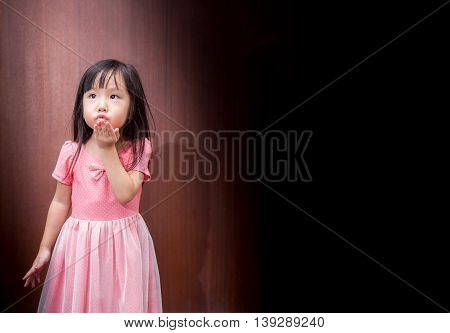 Portrait Of Asian Happy Little Girl , Blow A Kiss