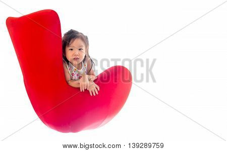 Asian girl child sit on the red sofa