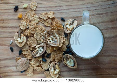 A mixture of grains nuts cereals and milk in a circle on a background tree.