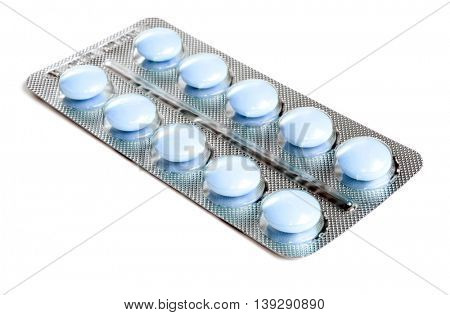 Pack of blue tablets isolated on white background.