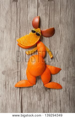 Funny kangaroo made of fruits on wooden board