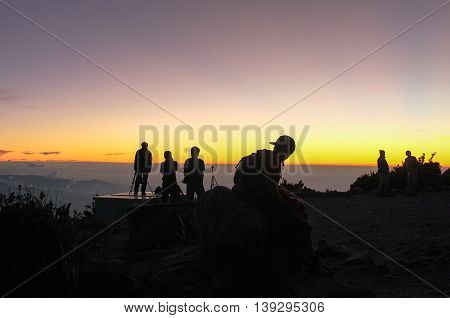 Ranau,Sabah,Malaysia-March 12,2016:Silhouette of a photographer framing a shot,taking pictures at sunset on Laban Rata.Sunset over the South China sea from Laban Rata.