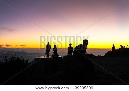 Ranau,Sabah,Malaysia - March 12, 2016:Group of climber embracing the beautiful sunset on Laban Rata at 3,273 meter above sea level.Sunset over the South China sea from Laban Rata