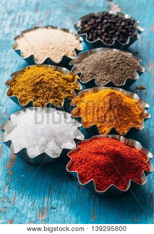 Spices on wooden bowl background. Herbs concept