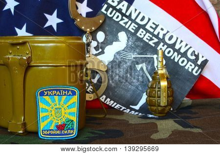 ILLUSTRATIVE EDITORIAL.Chevron of Ukrainian army.Background -Flag USA and Polish anti-ukrainian poster.Civil War in Ukraine.July 13 ,2016 in Kiev, Ukraine