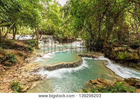 The clean turquoise waters of Kuang Si Falls near Luang Prabang, Laos