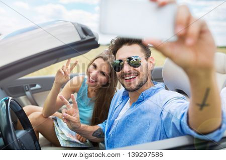 Couple taking a selfie while out on a road trip