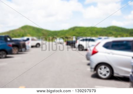 The Blurred Car Parking With Bokeh Light Background