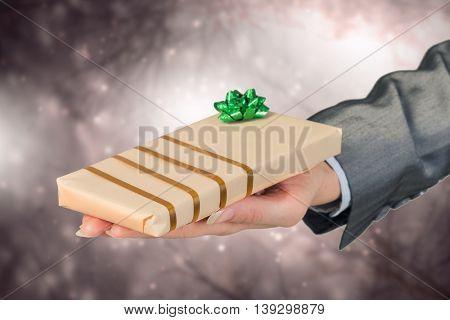 Woman presenting gift box . Mixed media