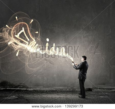 Businessman use tablet pc . Mixed media