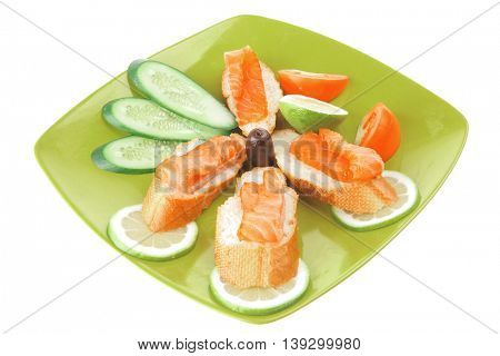 small salmon sandwich on green plate over white