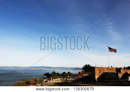 USA flag waving in the wind on the sky background