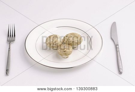 Vegetable dishes with fork and knife