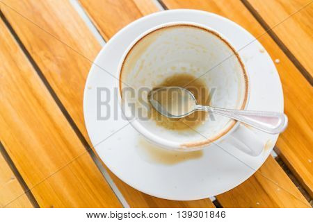 Empty cup of coffee on wooden table