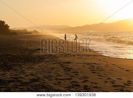 beach wave and footsteps at sunset time