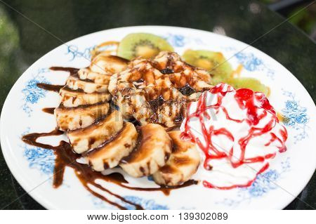 Waffles With Banana And Kiwi In The Plate