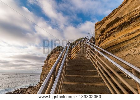 Side of cliff at Ladera Street with staircase, Sunset Cliffs in San Diego, California.
