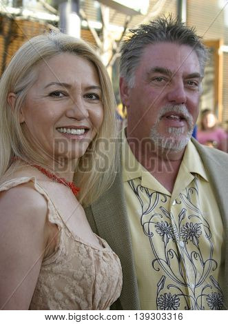 Bruce McGill and Gloria Lee at the Los Angeles premiere of 'Cinderella Man' held at the Gibson Amphitheatre at Universal City in Hollywood, USA on May 23, 2005.