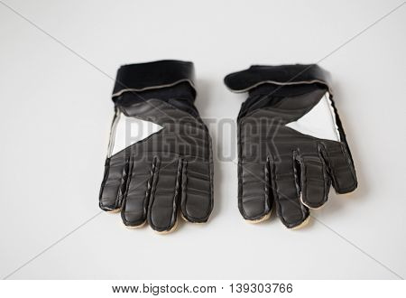 sport, football and sports equipment concept - close up of soccer goalkeeper gloves