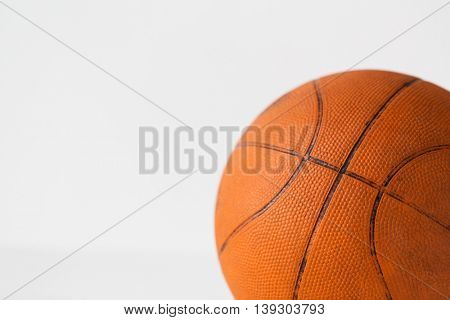 sport, fitness, game, sports equipment and objects concept - close up of basketball ball