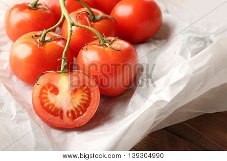 Bunch of red tomatoes in paper, close up