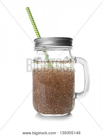 Chia seeds drink in glass jar with straw, isolated on white