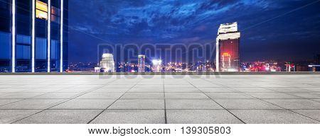 landmark modern office buildings in downtown of chongqing at twilight on view from empty patio