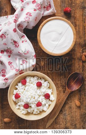 Farmers dairy products: sour cream and cottage cheese in bowls. Healthy rustic food still life