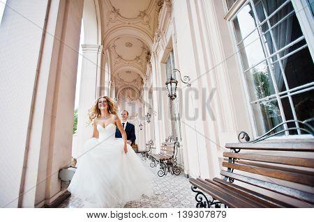 Elegant Wedding Couple At Old Vintage House