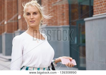 Outdoor portrait of young beautiful smiling woman