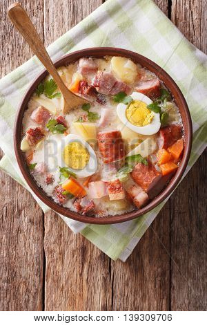 Zurek Soup With Smoked Meat Close Up On The Table. Vertical Top View