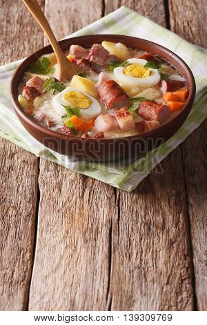 Polish Zurek Soup With Sausage, Vegetables And Eggs On The Table. Vertical