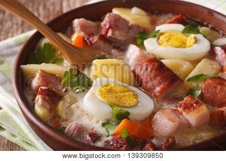 Thick Polish Soup Zurek With Sausage And Eggs Close-up. Horizontal