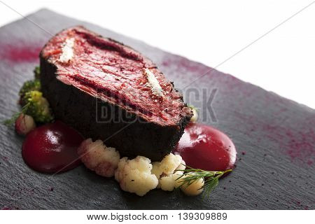 Delicious modern veal fillet served with sauce. Molecular cuisine with steak.