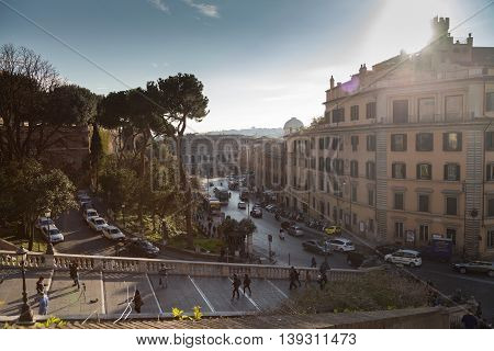 Rome, Italy - March 18, 2016: People walking on Piazza Venezia stairs. View of the historical center of Rome on a sunny spring day