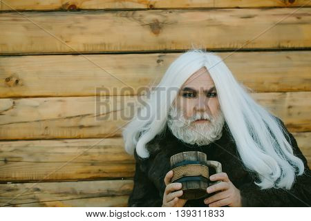 Bearded Man With Wooden Mug