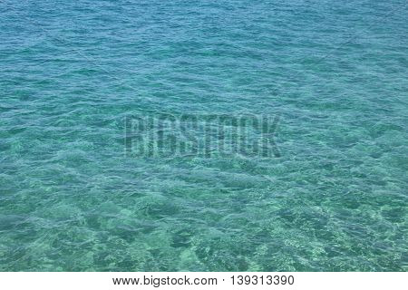 Beautiful sea and clear water. Blue sea surface with waves. Natural sea background.