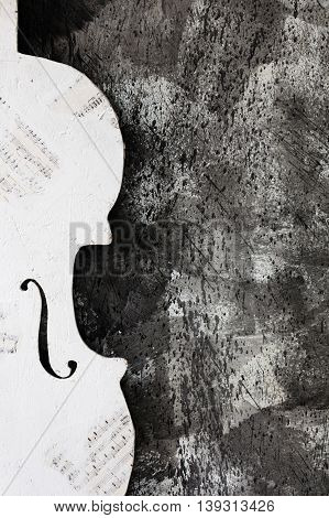 texture stone wall with white silhouette of a violin
