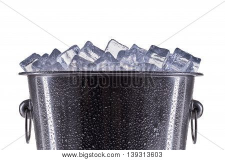 Metal champagne ice bucket with drops isolated on a white background.