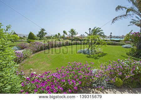 Formal landscaped gardens in grounds of a luxury tropical hotel resort