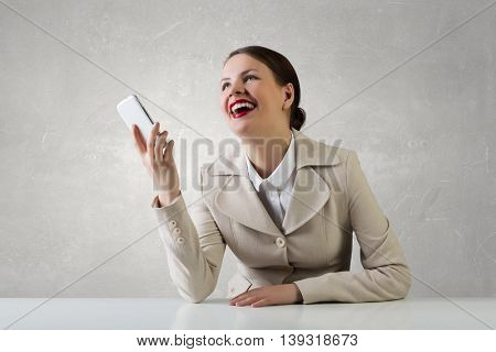 Attractive businesswoman having mobile conversation . Mixed media
